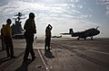 US Navy 060110-N-7241L-002 Flight deck personnel observe as an EA-6B Prowler assigned to the Shadowhawks of Electronic Attack Squadron One Four One (VAQ-141) makes an arrested landing.jpg