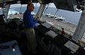 US Navy 060607-N-7526R-004 Cmdr. James Hineline, air boss, assigned aboard the Nimitz-class aircraft carrier USS Ronald Reagan (CVN 76), looks over the flight deck as Sailors prepare for flight operations in the South China Sea.jpg