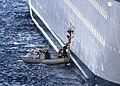 US Navy 061104-N-0730W-187 Sailors from the amphibious assault ship USS Wasp (LHD 1) assist an injured cruise ship passenger.jpg