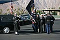 US Navy 061230-M-3913K-010 Military personnel assigned to the Armed Forces Honor Guard transport the flag-draped casket of former President Gerald R. Ford to awaiting Presidential aircraft.jpg