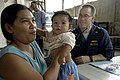 US Navy 070213-N-4399G-118 Cmdr. Nicholas Cardinale, USS Blue Ridge (LCC 19) medical officer, performs a routine health check on an infant during a medical capabilities (MEDCAP) community service project in Cebu City.jpg