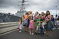 US Navy 070407-N-4856G-027 Families of Sailors stationed aboard guided missile destroyer USS Russell (DDG 59) wait patiently as the ship returns to Naval Station Pearl Harbor from a three-month deployment.jpg