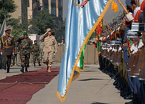 Combined Security Transition Command – Afghanistan - Adm. William J. Fallon Commander of U.S. Central Command salutes the Afghan honor guard on hand at the change of command ceremony for Combined Security Transition Command-Afghanistan (CSTC-A) in 2007.