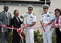 US Navy 070822-N-0807W-049 Capt. Tilghman D. Payne, commander of Fleet Activities Sasebo, and Mr. Tsuyoshi Oishi, Chief of Sasebo Defense Facilities Administration Office, cut the ceremonial ribbon at the grand opening of Fiddl.jpg