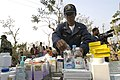 US Navy 071202-N-5642P-205 Lt. Pandora J. Liptrot, a Fleet Surgical Team 4 medical officer, sets up a mobile pharmacy in Sarankhola, Bangladesh.jpg