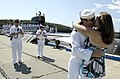 US Navy 080821-N-8467N-011 Joshua Grisham kisses his wife upon his return to Submarine New London in Groton.jpg