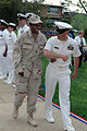 US Navy 090429-N-8936G-005 Hospital Corpsman 1st Class Diane Sanders of Naval Health Clinic Annapolis is escorted by Chief Boatswain's Mate William Grammer at the Naval Support Activity Annapolis Individual Augmentee (IA) homec.jpg
