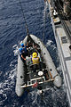 US Navy 090823-N-4275Y-002 Sailors assigned to the guided-missile frigate USS Carr (FFG 52) lower bales of seized cocaine on to the ship's rigid hull inflatable boat to transfer to the Venezuelan Navy frigate General Soublette.jpg