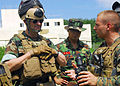 US Navy 090823-N-9573A-028 Lance Cpl. Tom Canzano, right, of Farmington, N.Y., assigned to Fleet Anti-terrorism Security Team Pacific (FAST PAC), explains to Vice Adm. John M. Bird, left, commander, U.S. 7th Fleet.jpg