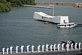 US Navy 091013-N-4995K-073 Sailors assigned to the aircraft carrier USS Ronald Reagan (CVN 76) render honors to the USS Arizona Memorial.jpg