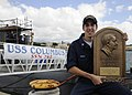 US Navy 091117-N-3560G-005 Junior Sailor of the Quarter Electrician's Mate 2nd Class Cole Parks displays the Arleigh Burke Trophy.jpg