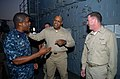 US Navy 091118-N-3925A-002 Rear Adm. Sinclair Harris speaks with Capt. Kevin Couch nd Command Master Chief Hassan Lamont.jpg