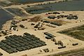 US Navy 100221-N-9643W-003 An aerial view of the White Beach logistical compound established by Sailors assigned to Amphibious Construction Battalion (ACB) 2 at Varreoux Beach in Port-au-Prince, Haiti.jpg
