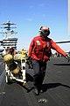US Navy 100306-N-3038W-587 Aviation ordnancemen transport MK 83 1,000-pound general purpose bombs.jpg