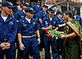 US Navy 100423-N-2013O-017 Sailors receive flowers following a community service project in Goa, India.jpg