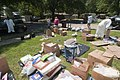 US Navy 100506-N-5319A-015 Volunteers help Ship's Serviceman 1st Class Scott Overstreet and his wife remove their belongings after severe flooding damaged many of their personal items in a family housing area of Naval Support A.jpg