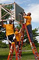 US Navy 100610-N-4971L-154 Sailors deployed aboard Swift (HSV 2) sand a basketball goal during a community service project in Corinto, Nicaragua.jpg