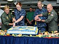 US Navy 101013-N-6632S-040 Sailors cut a cake in celebration of the Navy's 235th birthday.jpg