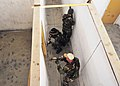 US Navy 101106-N-4044H-004 Navy SEALs practice close quarters combat while approaching a door in a simulated home at U.S. Training Center Moyock.jpg