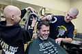 US Navy 110326-N-3542S-003 A current and former patient of the pediatric oncology ward at Naval Medical Center Portsmouth shave the head of Capt. T.jpg