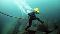 US Navy 110629-N-XD935-139 Navy Diver 3rd Class Bryan Myers leaps from rock to rock along the ocean floor during diving operations.jpg