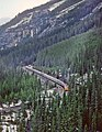 VIA 1414 with the eastbound Canadian is between Yoho and Cathedral on CP's big hill from Kicking Horse Pass to Field, BC in May 1982 -- 3 photos (31431464553).jpg