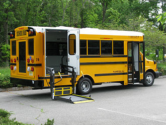 Van Con - A Van-Con school bus based on a Chevrolet Express, showing its deployed wheelchair lift.