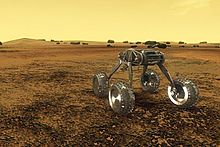 a spindly four-wheeled robot moves across Venus's dark surface, against its yellow sky