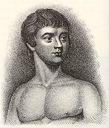 A black and white print of Victor of Aveyron as a teenager from the chest up and shirtless, with his body facing forward and his face slightly turned to the left.
