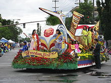 """Freedom Bird"" parade float, ridden by women and children"