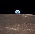 View from the Apollo 11 shows Earth rising above the moon's horizon.jpg