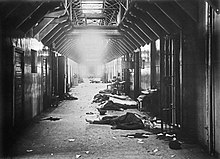 Around eight bodies are lying around a hallway after the Vyborg county jail massacre, an example of Red Terror. Thirty White prisoners were killed by the Reds.