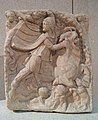 Votive relief to Mithras, the oriental god Mithras kills the sacred bull and from its blood and semen arise the plants and animals, 2nd century AD, Neues Museum, Berlin (8168905979).jpg