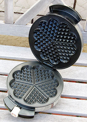 This is an electric waffle maker (also known a...