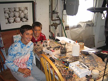Two boys at the table where they paint Warhamm...