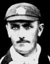 A close up of a man in an MCC cap