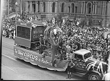 black and white photograph of Sydney street parade with an elephant on a circus float