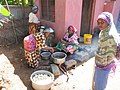 Women cooking using the open fire stove.jpg
