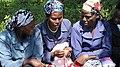 Women examining Menstrual Cups (5926114037).jpg