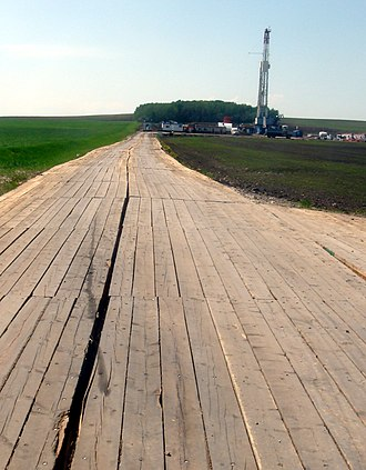 Plank road - A wood mat road in British Columbia, used for temporary access over soft ground