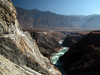 Three Parallel Rivers - The upper reaches of the Yangtze River, bearing north having just emerged from the Tiger Leaping Gorge.
