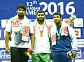 Zaman Avwar (Pakistan) winner of Gold in the 125Kg Free Style wrestling with Silver medallist Mandeep (India) and Bronze medallist R Rasool (Afghanistan), during the presentation ceremony, at the 12th South Asian Games-2016.jpg