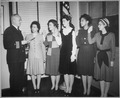 """Cmdr. Thomas A. Gaylord, USN (Ret'd), administers oath to five new Navy nurses commissioned in New York..."", 03-08-1945 - NARA - 520618.tif"