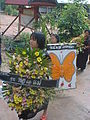 05 Girl Carrying Flowers at Wat Grong Greng.JPG