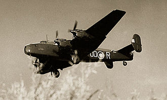 RAF Holme-on-Spalding Moor - A Handley Page Halifax of No. 1663 Heavy Conversion Unit based at Rufforth, Yorkshire, getting airborne from RAF Holme-on-Spalding Moor during a training flight, circa 1943