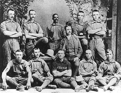 Bud Fowler, the first professional black baseball player with one of his teams, Western of Keokuk, Iowa 1885 Keokuk, Iowa baseball team featuring Bud Fowler.jpg