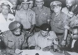Pakistan's Lt Gen Niazi(sitting second from right) signing the Instrument of Surrender, following the defeat of Pakistan in the Indo-Pakistani War of 1971.
