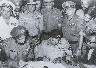 Indian Armed Forces - Pakistan's Lt. Gen. A. A. K. Niazi signing the instrument of surrender in Dhaka on 16 Dec' 1971, in the presence of India's Lt. Gen. Aurora. Standing behind them are officers of India's Army, Navy and Air Force. The 1971 War directly involved participation of all three arms of Indian Armed Forces.