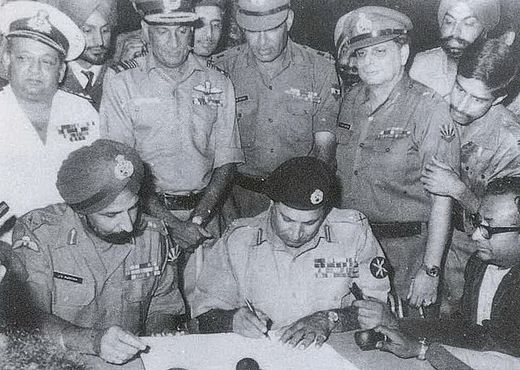 Pakistan's Lt. Gen. A. A. K. Niazi signing the instrument of surrender in Dhaka on 16 Dec' 1971, in the presence of India's Lt. Gen. Aurora. Standing behind them are officers of India's Army, Navy and Air Force. The 1971 War directly involved participation of all three arms of Indian Armed Forces. 1971 Instrument of Surrender.jpg