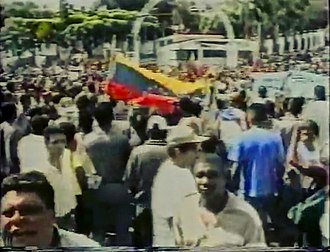 2002 Venezuelan coup d'état attempt - Chavista loyalists gathered outside of Miraflores Palace after hearing that Chávez had not resigned the presidency.